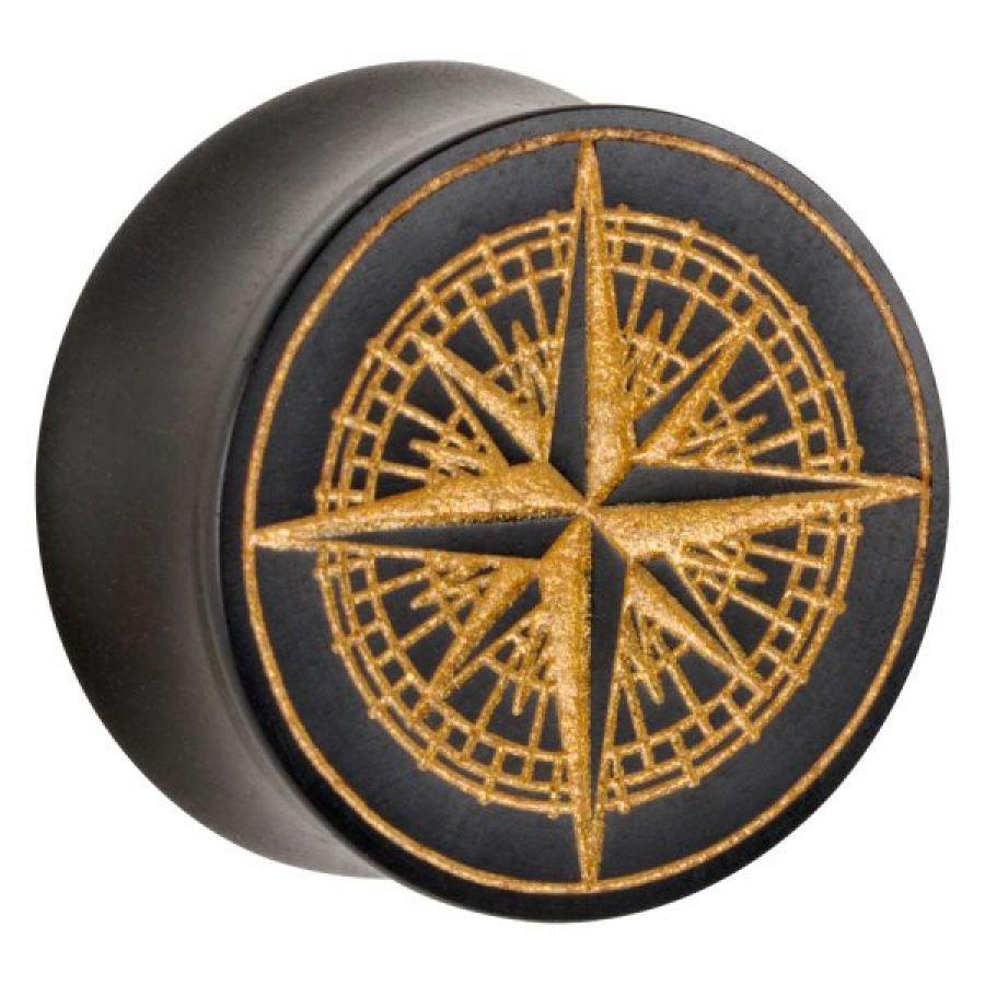 Golden Compass on negru lemn